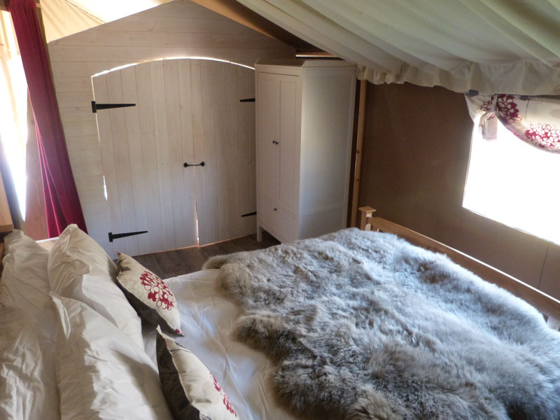 The king sized double bed with access to the cabin bed